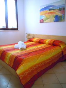 A bed or beds in a room at Residence Favonio