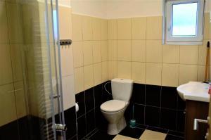A bathroom at Apartments - bungalows Eder