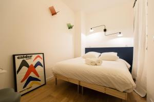 A bed or beds in a room at Private Apartment 2 -Old Town