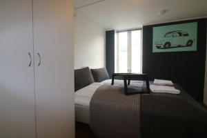 Cama o camas de una habitación en Apart Stavanger Signature Apartment Hotel