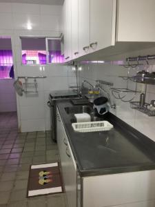 A kitchen or kitchenette at Coronado Apart