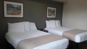 A bed or beds in a room at Best Studio Inn Homestead (Extended Stay)