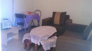 A seating area at 1 Bedroom Down White 1