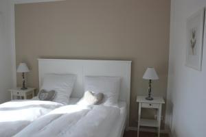 Ein Bett oder Betten in einem Zimmer der Unterkunft Ferienwohnung Ammersee