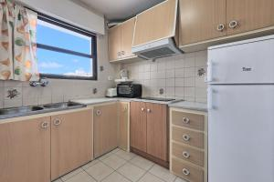 A kitchen or kitchenette at All Suite Ibiza Aparthotel