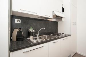 A kitchen or kitchenette at Magia in Trastevere