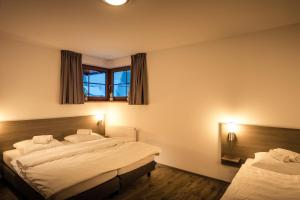 Postel nebo postele na pokoji v ubytování Residence Lipno