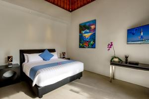 A bed or beds in a room at Villa Ley