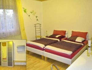 Ein Bett oder Betten in einem Zimmer der Unterkunft W.& M.Schattka