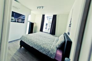 A bed or beds in a room at Les Suites de Nanesse