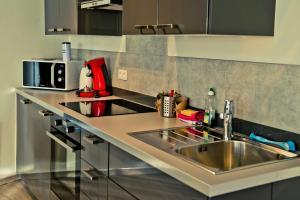 A kitchen or kitchenette at Les Suites de Nanesse
