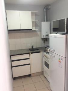 A kitchen or kitchenette at Varadero II