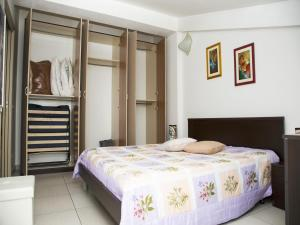 A bed or beds in a room at Casa Vacanze Pina