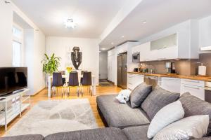 Svetainės erdvė apgyvendinimo įstaigoje Go Happy Home Apartments