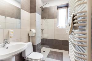 Łazienka w obiekcie Aparthotel Oberża