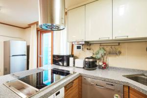 A kitchen or kitchenette at Merci Stay