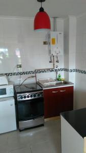 Una cocina o zona de cocina en Cabañas del Profe, Puerto Montt