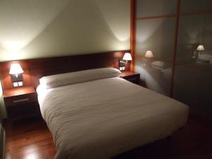 Cama o camas de una habitación en Roca Nevada Resort
