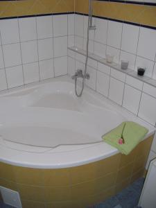 A bathroom at Serviced Apartment with Sunny Balcony