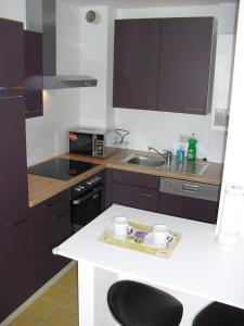 A kitchen or kitchenette at Serviced Apartment with Sunny Balcony