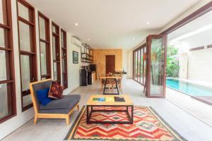 A seating area at The Royal Bali Villas Canggu