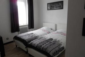 מיטה או מיטות בחדר ב-Appartement Sly