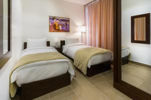 A bed or beds in a room at Nadine Hotel Suites