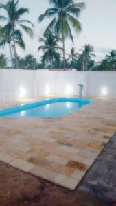 The swimming pool at or near Apartamentos em Peroba