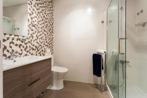 Uma casa de banho em Graca Deluxe Apartments   RentExperience
