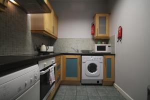 A kitchen or kitchenette at IFSC Dublin City Apartments