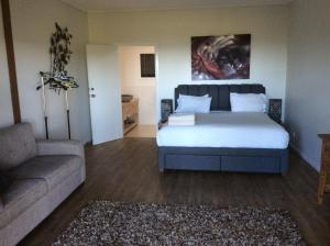 A bed or beds in a room at Amira Holiday home