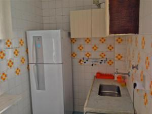 A kitchen or kitchenette at Guarujá Apartment