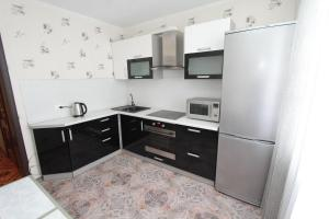 A kitchen or kitchenette at U Megapolisa Apartment