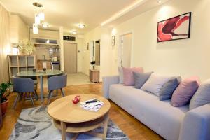 A seating area at Apartments Promenada