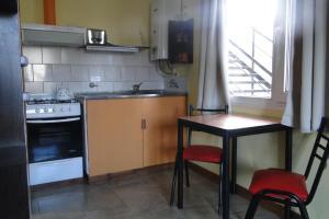 A kitchen or kitchenette at Malvinas