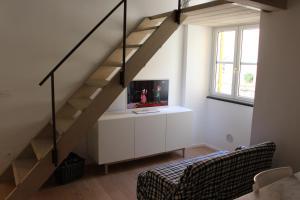 Telewizja i/lub zestaw kina domowego w obiekcie Appartamento della Baia