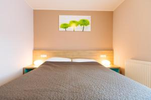 A bed or beds in a room at Maline Apartments