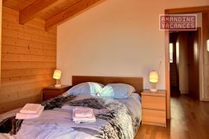 Ein Bett oder Betten in einem Zimmer der Unterkunft Chalet L'Escalade