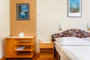 A bed or beds in a room at Apartments Lovorik