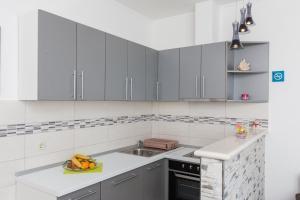 A kitchen or kitchenette at Apartments Doris