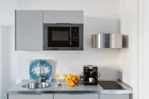 Een keuken of kitchenette bij Dolac One Apartments