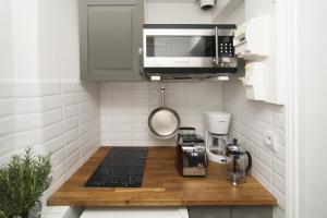 A kitchen or kitchenette at My Nest Inn Paris Panthéon