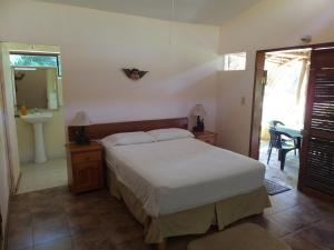 A bed or beds in a room at Posada Mazuntinas
