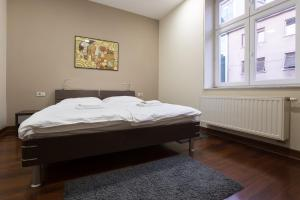 A bed or beds in a room at Apartments Zagreb Point - Vinogradska