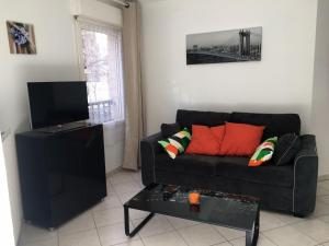 A seating area at Appartement Rives du Lez