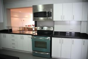 A kitchen or kitchenette at Beautiful Apartment fully furnished