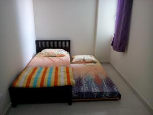 A bed or beds in a room at Homestay Puncak Alam Residensi Allamanda