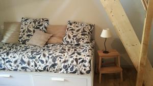 Un ou plusieurs lits dans un hébergement de l'établissement La petite maison