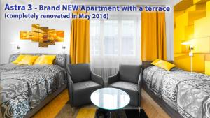 A bed or beds in a room at Astra 3 - Large Apartment with Terrace