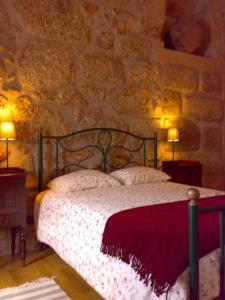 Quinta da Tapada do Pontão tesisinde bir odada yatak veya yataklar